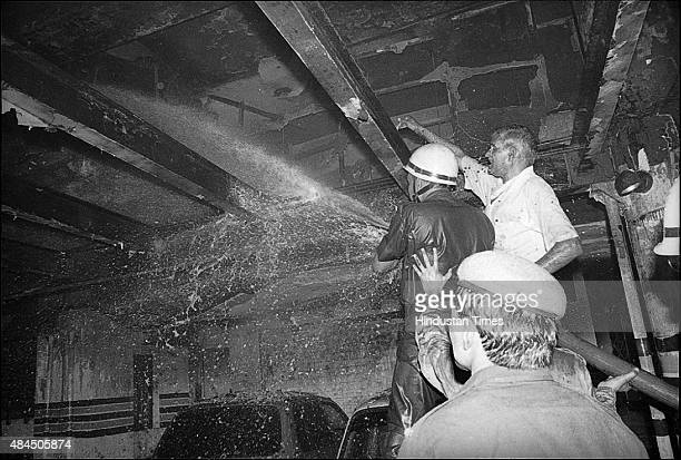Firemen fighting the fire at Uphaar Cinema in which Fiftynine people trapped in the balcony of the theatre died of asphyxia on June 13 1997 in New...