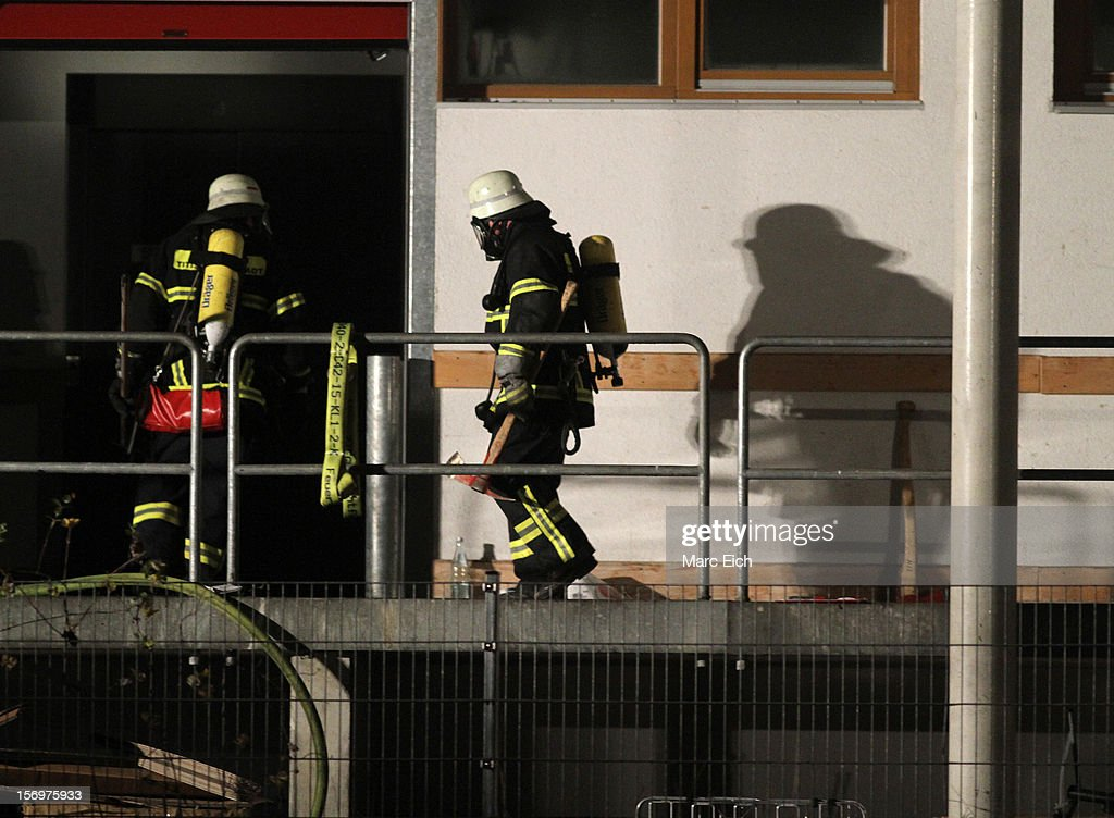 Firemen go into a Caritas employment facility for the handicapped in which 14 people died in a fire on November 26, 2012 in Titisee-Neustadt, Germany. The fire was reportedly caused by an explosion at the facility, where approximately 120 people with disabilities are employed in light manufacturing.