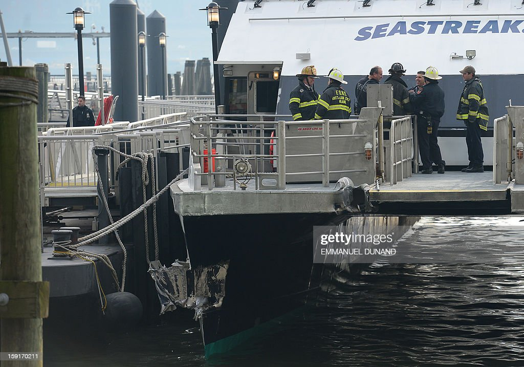 Firemen inspect the commuter ferry after it slammed into a pier in New York, January 9, 2013. About 50 people were injured when a rush-hour ferry packed with commuters smashed into a pier in New York City on Wednesday, firefighters said. The accident took place at 8:45 am (1345 GMT) on Pier 11 in the East River in lower Manhattan, not far from Wall Street, the New York Fire Department said. The ferry was arriving from New Jersey. 'We are assessing 50 patients on the scene right now. We don't know what kind of injuries they have,' an NYFD spokeswoman said.