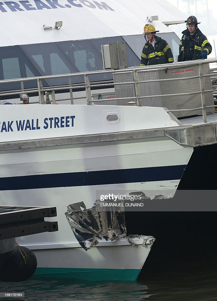 Firemen inspect the damage after a commuter ferry slammed into a pier in New York, January 9, 2013. About 50 people were injured when a rush-hour ferry packed with commuters smashed into a pier in New York City on Wednesday, firefighters said. The accident took place at 8:45 am (1345 GMT) on Pier 11 in the East River in lower Manhattan, not far from Wall Street, the New York Fire Department said. The ferry was arriving from New Jersey. 'We are assessing 50 patients on the scene right now. We don't know what kind of injuries they have,' an NYFD spokeswoman said. AFP PHOTO/EMMANUEL DUNAND