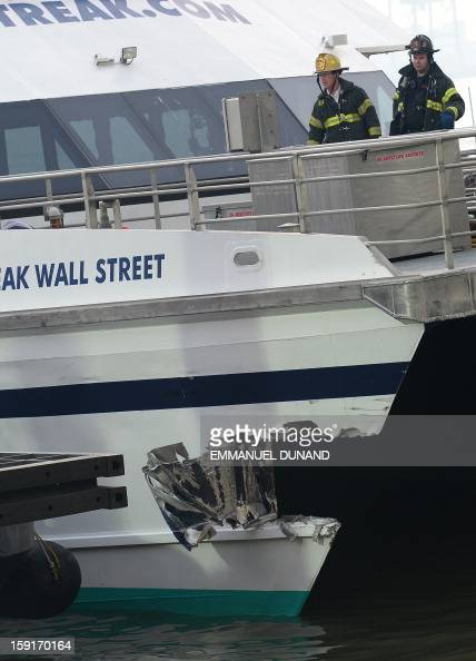 Firemen inspect the damage after a commuter ferry slammed into a pier in New York January 9 2013 About 50 people were injured when a rushhour ferry...