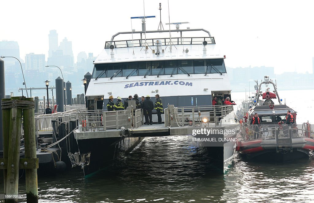 Firemen inspect the damage after the commuter ferry slammed into a pier in New York, January 9, 2013. About 50 people were injured when a rush-hour ferry packed with commuters smashed into a pier in New York City on Wednesday, firefighters said. The accident took place at 8:45 am (1345 GMT) on Pier 11 in the East River in lower Manhattan, not far from Wall Street, the New York Fire Department said. The ferry was arriving from New Jersey. 'We are assessing 50 patients on the scene right now. We don't know what kind of injuries they have,' an NYFD spokeswoman said.