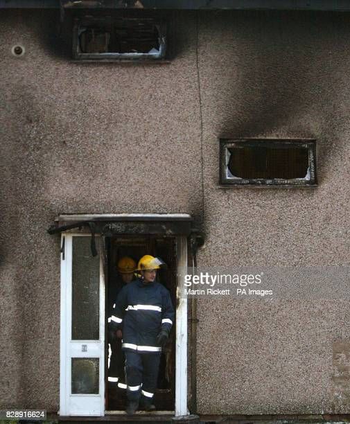 Firemen inspect the house in Will Griffiths Walk Beswick Manchester where a fire killed three young children and an adult The four bodies were...