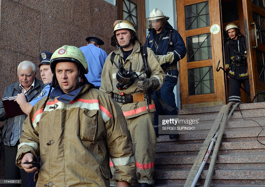 Firemen leave after they extinguished a fire in one of the halls of the Ukrainian National Museum of Natural History, one of the most popular museums of Kiev, on July 25, 2013. No casualties have been reported but some exhibits were damaged as a result of the fire. Experts examine the causes of the fire.