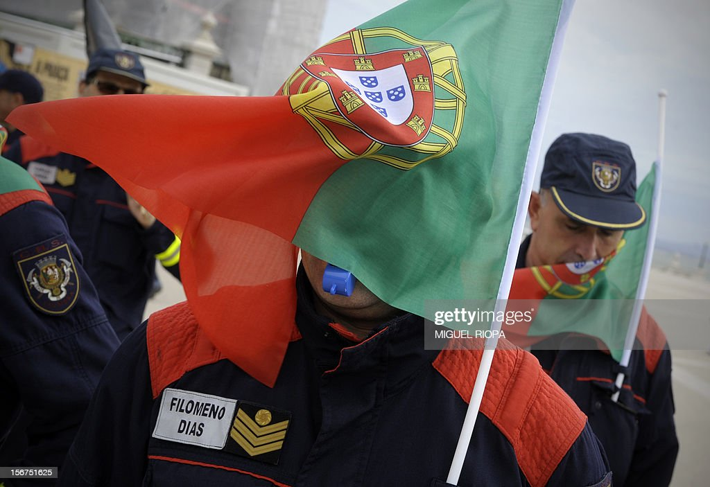 Firemen march at Comercio Square in Lisbon, on November 20, 2012, during a demonstration against the govenrment's austerity policies. The government aims to save 4.0 billion euros via state reform measures, but its austerity budgets have led to howls of protest from civil servants and trade unions in particular. AFP PHOTO/ MIGUEL RIOPA