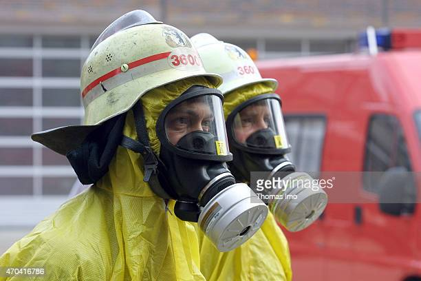 Firemen of the Berlin fire brigade wearing protective suits helmets and gas masks on October 18 2001 in Berlin Germany