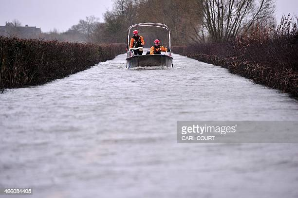 Firemen operate a rescue boat service between the flooded village of Muchelny and Langport in Somerset southwest England on January 31 2014 Parts of...