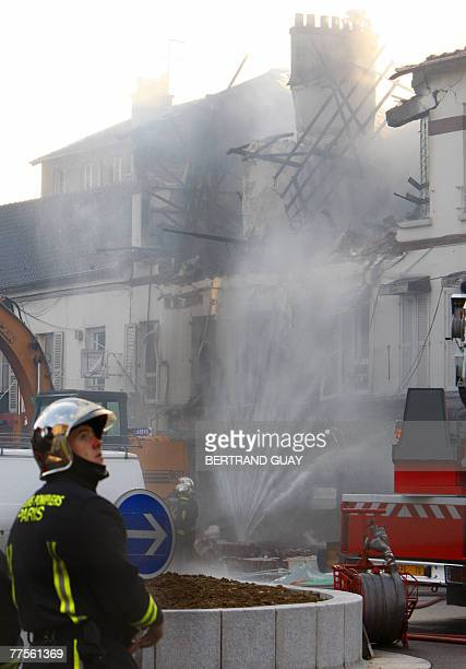 Firemen stand at the site of accidental gaz pipe explosion next to a restaurant 30 October 2007 in Bondy northeast of Paris Fortyone people were...