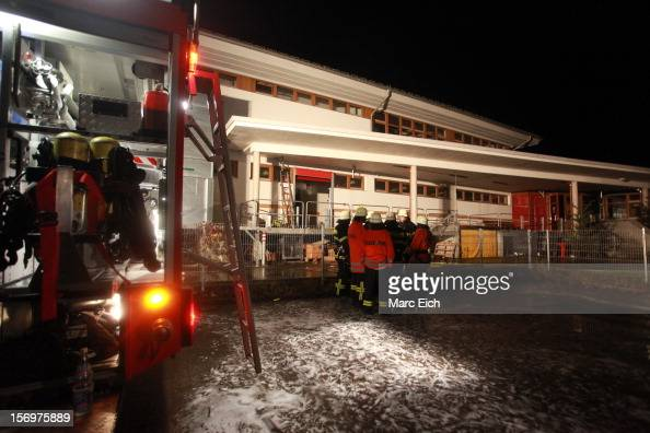 Firemen stand outside a Caritas employment facility for the handicapped in which 14 people died in a fire on November 26 2012 in TitiseeNeustadt...