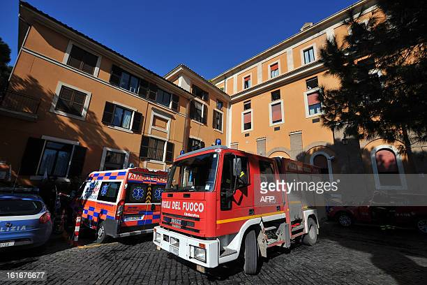Firemen stand outside the Fatebene Fratelli hospital on the Tiberina island in Rome on February 14 2013 The fire started in the department of...