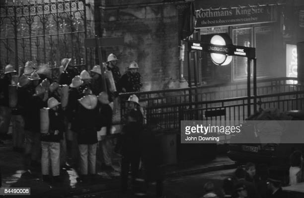 Firemen standing outside King's Cross Station following a fire in which 31 people were killed 19th November 1987