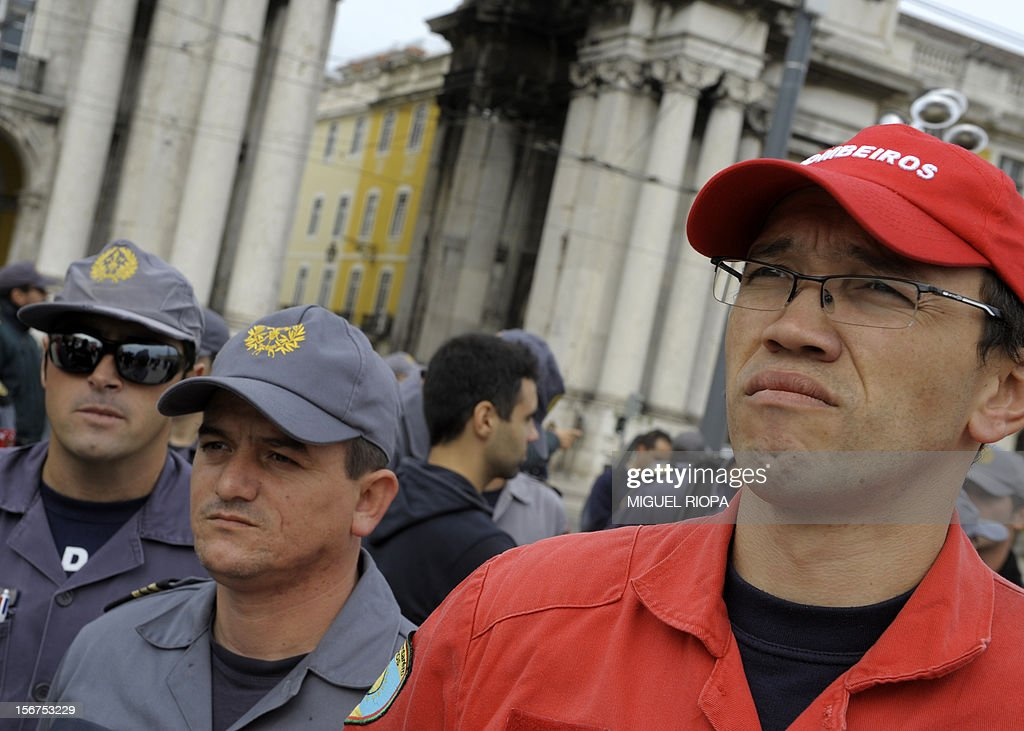 Firemen stands attend a demonstration against the govenrment's austerity measures at Comercio Square in Lisbon, on November 20, 2012. The government aims to save 4.0 billion euros via state reform measures, but its austerity budgets have led to howls of protest from civil servants and trade unions in particular.