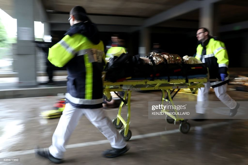 Firemen take part in a terrorist attack mock exercise on May 31, 2016 near the Stade de France in Saint-Denis, France