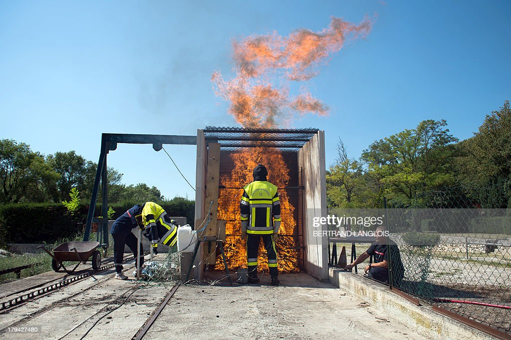 Firemen test a new protective suit to fight against the forest blazes on September 3, 2013 in Gardanne near Marseille, southeastern France.