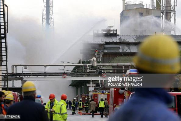 Firemen try to extinguish flames at a burning storage building of a fertilizer plant in Krefeld western Germany on September 25 2012 The cause of the...