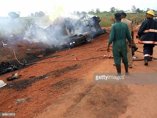 Firemen try to to extinguish a burning fuel tanker on November 26 2008 after 25 people were killed and 54 injured when it exploded in the central...