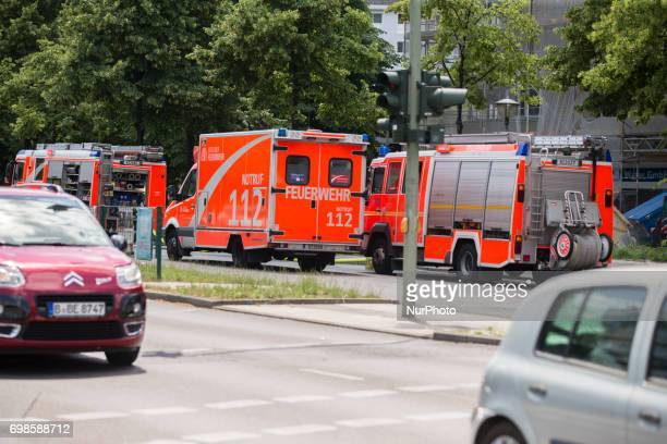 Firemen vagons are seen in Kreuzberg after a fire broke out in a construction site in Berlin Germany on June 19 2017