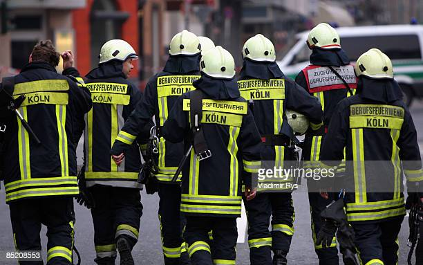 Firemen walk nearby the ruine of the building of the Historical Archive of the City of Cologne after it collapsed on Tuesday due to until yet unknown...