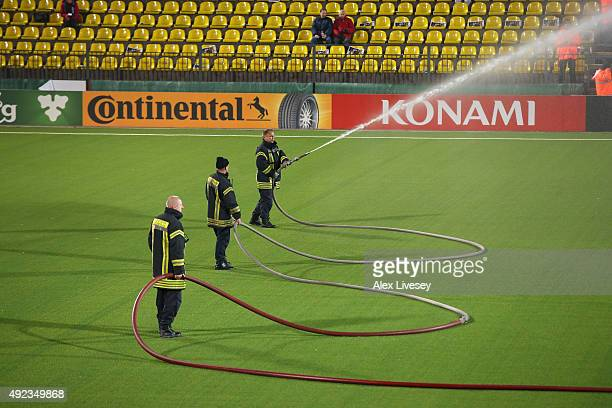 Firemen water the pitch prior to the UEFA EURO 2016 qualifying match between Lithuania and England at the LFF Stadium on October 12 2015 in Vilnius...