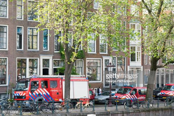 Firemen with their trucks in Amsterdam