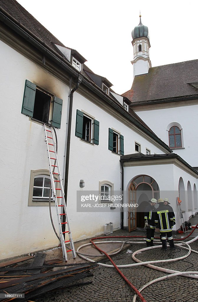 Firemen work at a Franciscan monastery in Fuessen, southern Germany, after a fire broke out on January 6, 2013. Ten monks, including one aged 100 years old, have been injured during the fire. Emergency services managed to get all the residents -- aged between 42 and 100 -- out of the burning building. The monastery sustained around 100,000 euros ($131,850) worth of damage and, according to police, numerous objects of art history were damaged.