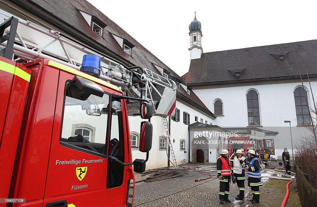 Firemen work at a Franciscan monastery in Fuessen, southern Germany, after a fire broke out on January 6, 2013. Ten monks, including one aged 100 years old, have been injured during the fire. Emergency services managed to get all the residents -- aged between 42 and 100 -- out of the burning building. The monastery sustained around 100,000 euros ($131,850) worth of damage and, according to police, numerous objects of art history were damaged. AFP PHOTO / KARL-JOSEF HILDENBRAND GERMANY OUT