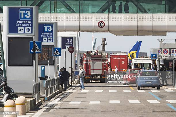 Firemen work at Fiumicino International Airport after a fire broke out overnight on May 07 2015 Rome's main airport gradually resumed normal...
