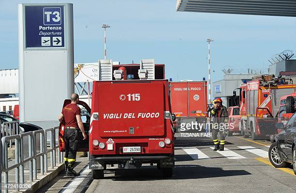 Firemen work at Rome's Fiumicino international airport after a fire broke out overnight on May 7 2015 No serious injuries were reported as a result...