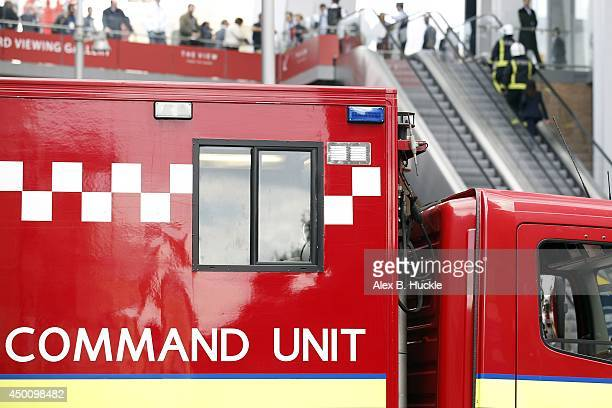 Firemen work in the area as people evacuate The Shard on June 5 2014 in London England The Shard London's tallest building standing at 310 meters...