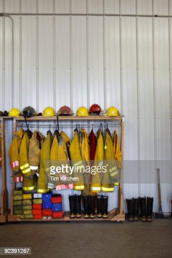 Firemen's gear in firehouse