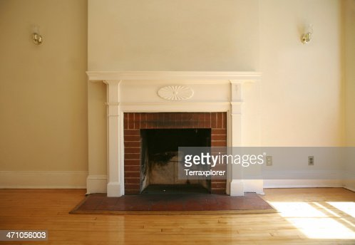 Fireplace In Empty Living Room Stock Photo
