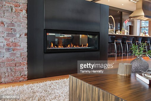 Fireplace in modern interior : Stock Photo