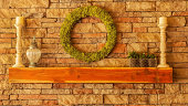 Cedar wood mantel on a stone fireplace with decorations
