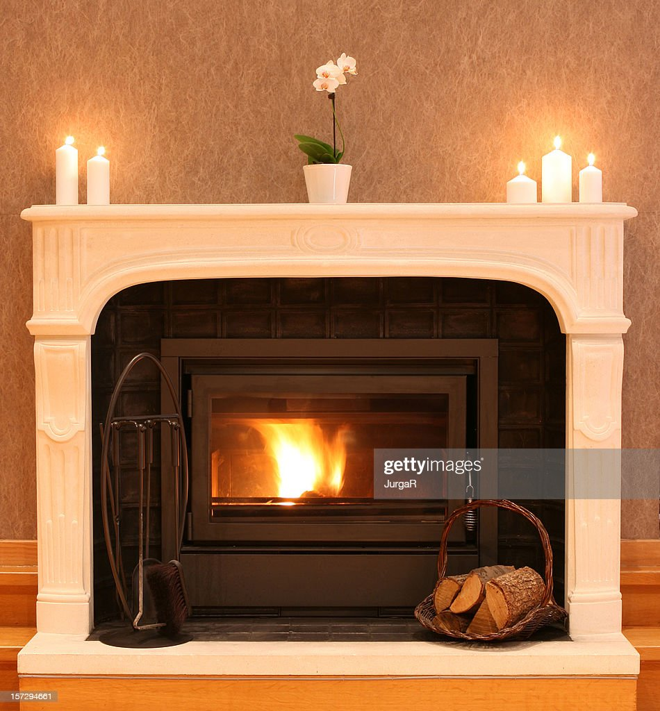 fireplace with burning firewood in the cozy living room stock