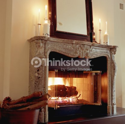 Fireplace with candles on mantle foto stock thinkstock - Insert pour grande cheminee ancienne ...