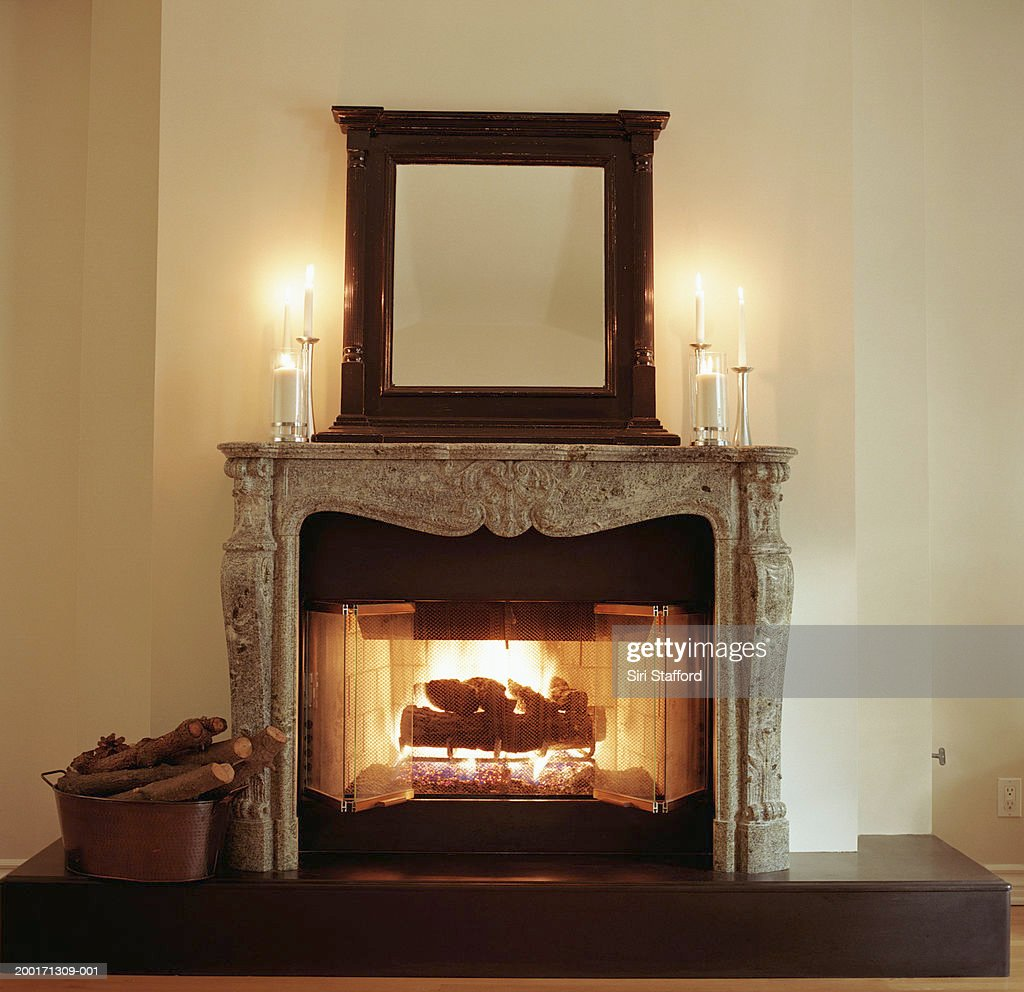 Fireplace with candles on mantle