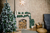 Classic christmas decorated fireplace and christmas tree