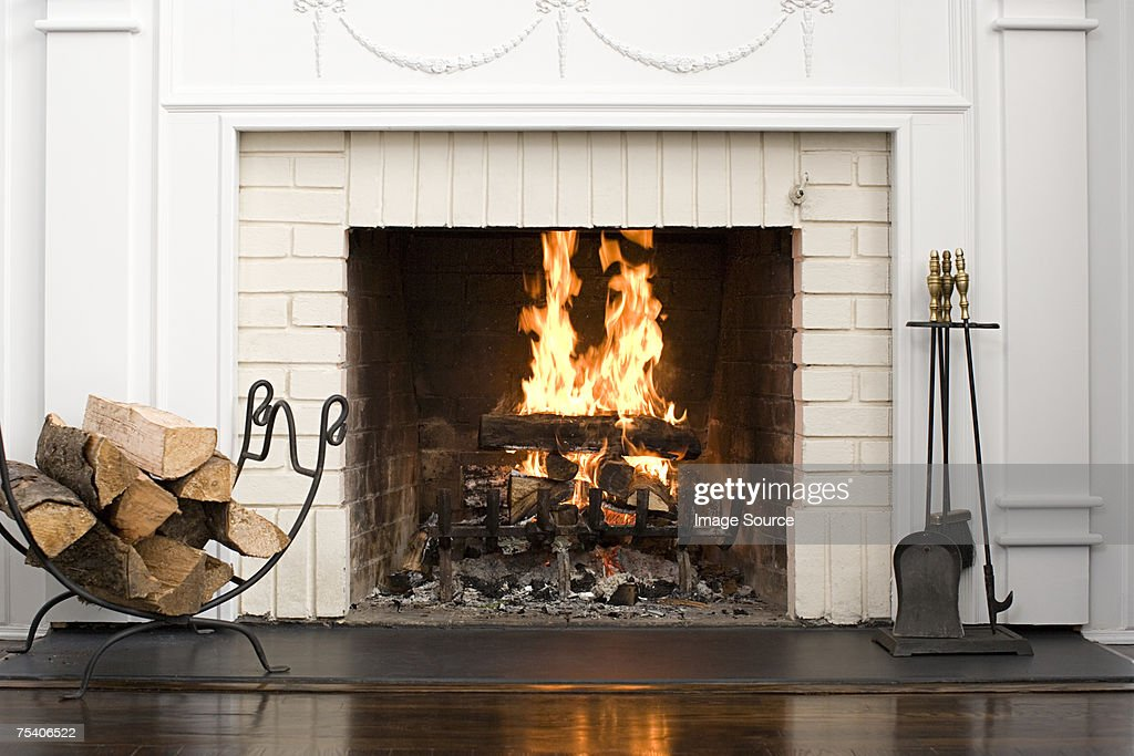 Fireplace with fire burning