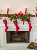 Fireplace with holiday decorations and stockings