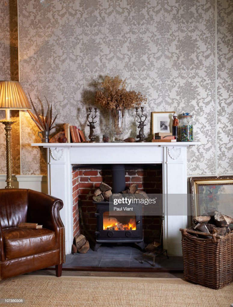 fireplace with log burner : Stock Photo