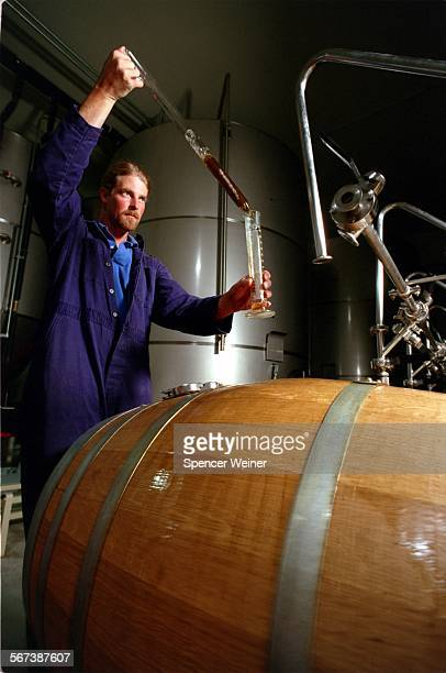 Firestone Walker Brewmaster Jeffers Richardson samples beer fermenting in the 'union' a system of American Oak barrels that the beer rests in during...