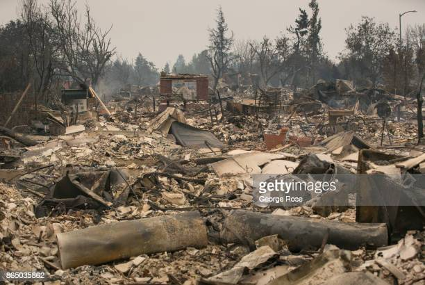 A firestorm that began in Napa Valley's Calistoga destroys more than 800 homes just in the Coffey Park neighborhood is viewed on October 10 in Santa...