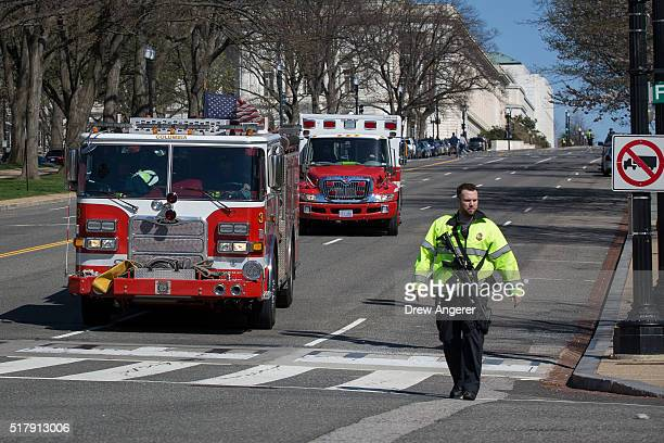 A firetruck and ambulance leave the Capitol grounds as they drive down Constitution Avenue after gun shots were reportedly fired at the US Capitol...