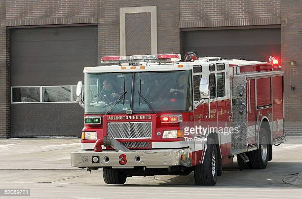 A firetruck departs its firehouse enroute to a call January 31 2005 in Arlington Heights Illinois According to an analysis by The Boston Globe...