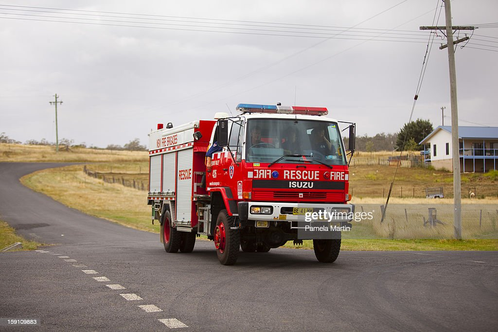 A firetruck drives along the Monaro Highway on January 8, 2013 in Nimmitabel,New South Wales, Australia. NSW was declared a total fire ban with the Illawarra, Shoalhaven and Southern Ranges regions placed on 'Catastrophic' alert.