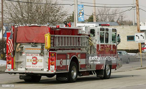 A firetruck drives down a street enroute to a call January 31 2005 in Arlington Heights Illinois According to an analysis by The Boston Globe...