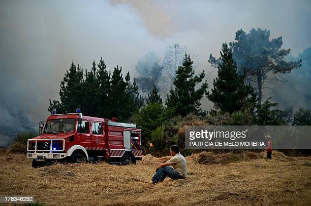 A firetruck is parked as locals and firefighters battle a wildfire in Caramulo central Portugal on August 29 2013 Five Portuguese mountain villages...