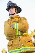 Firewoman standing outdoors wearing helmet