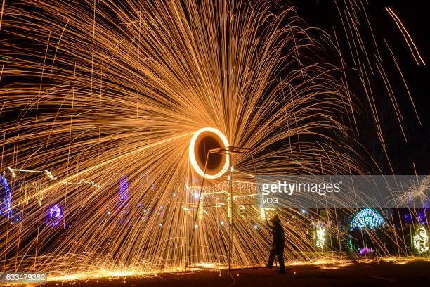 Firework consisting of molten iron is set off at a scenic area in Neihuang County to celebrate the Lunar New Year on January 31 2017 in Anyang Henan...