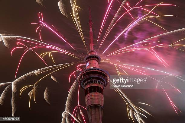 Firework display from the top of the Sky Tower to welcome the New Year on January 1 2015 in Auckland New Zealand